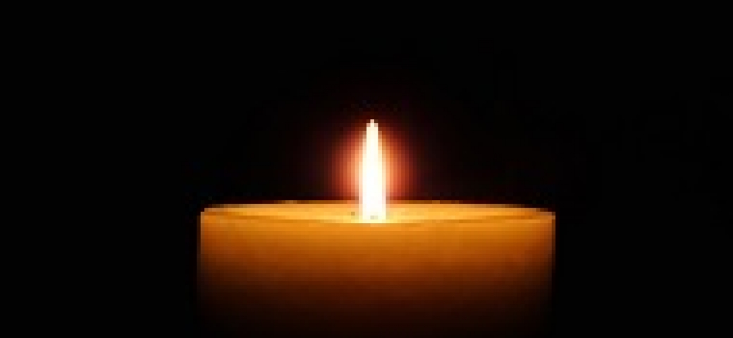 candle lit in the dark