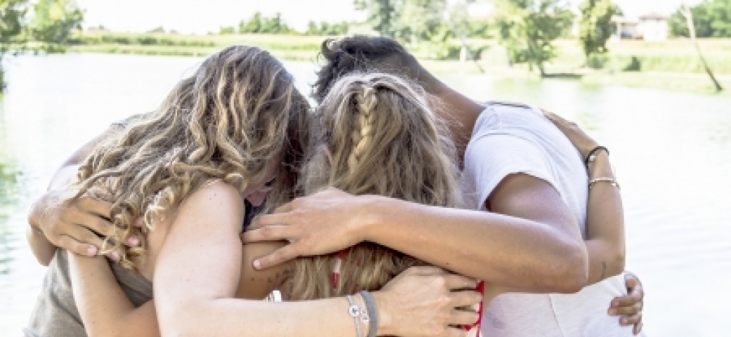 three friends of different races hugging