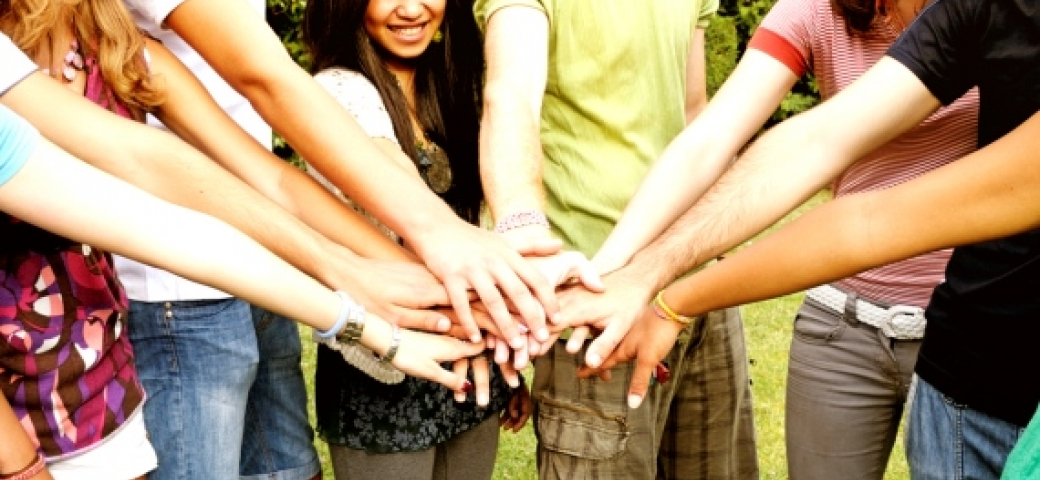 friends in a circle stacking hands