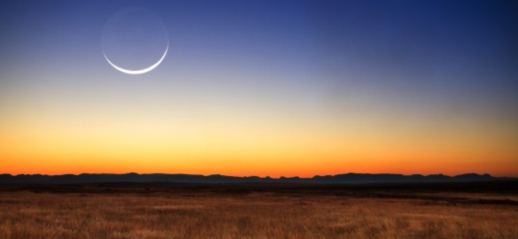 New moon over sunset