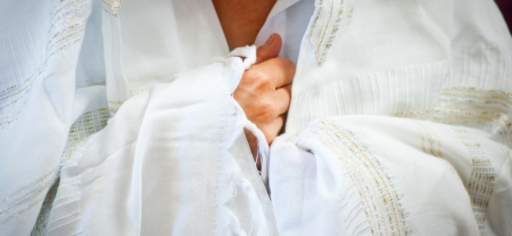 person wrapped in white tallit