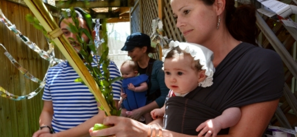 woman and child shaking lulav and etrog