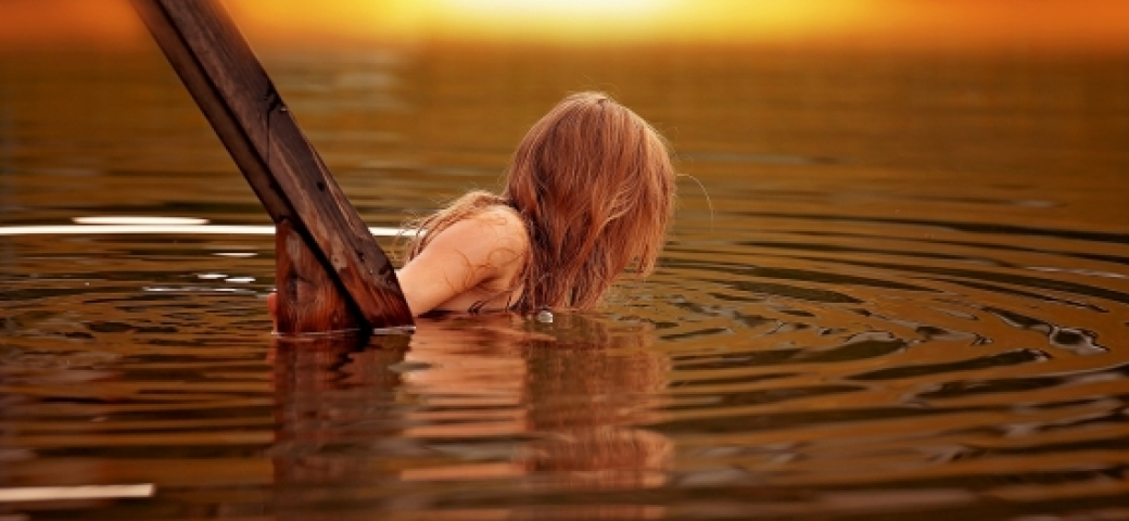 woman immersing in water