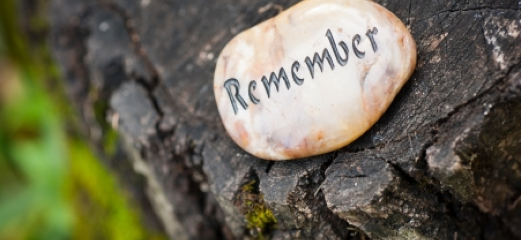 stone that says the word remember