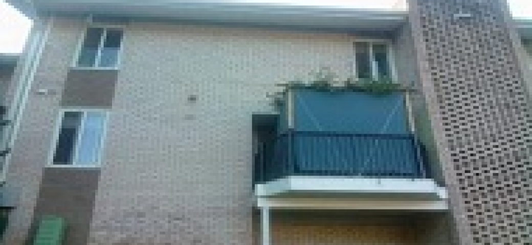 sukkah on a balcony in an apartment complex