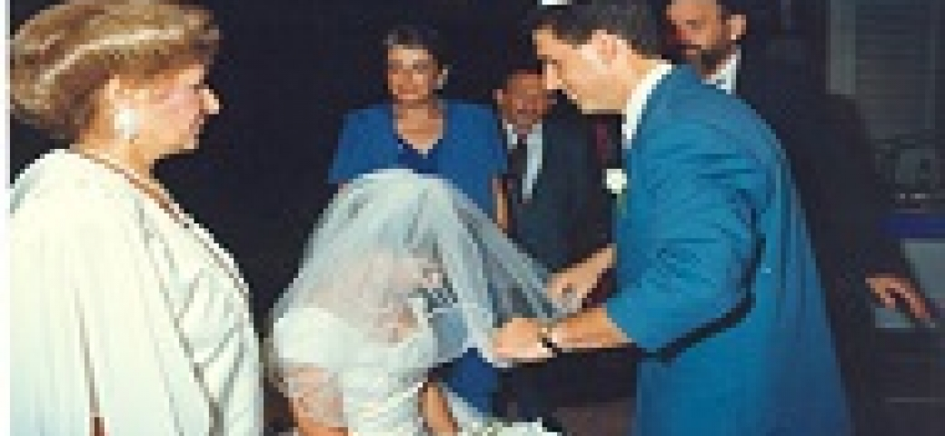 man unveiling bride