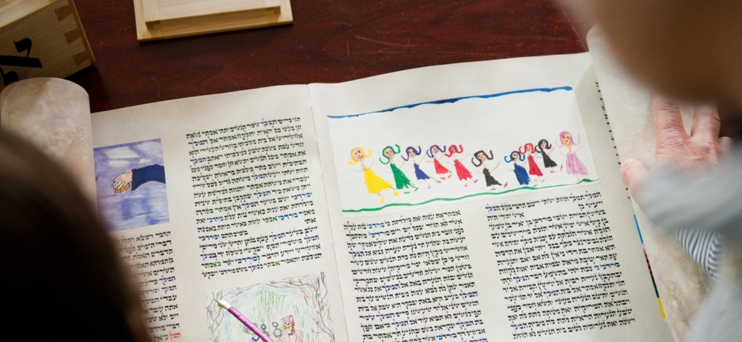 people chanting from colorful megillah