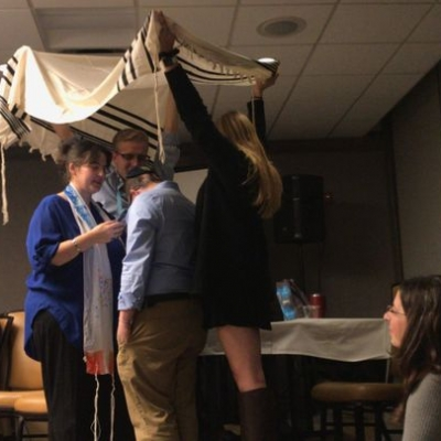 Standing under Spencer's tallit together - Heather Paul, Spencer Kaseff, and witnesses, Trent Works and Eliana Micahelson
