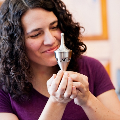 woman smelling havdallah spices