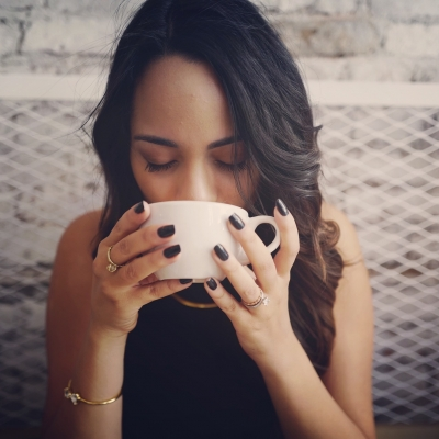 woman drinking coffee with eyes closed