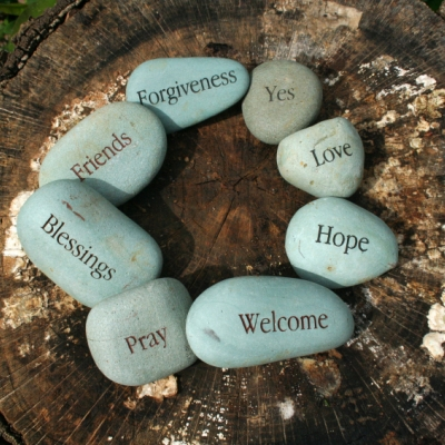 stones in a circle with inspiring words like welcome, hope, blessings, love