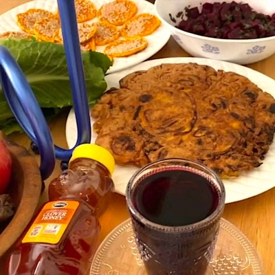 table set with various rosh hashanah foods