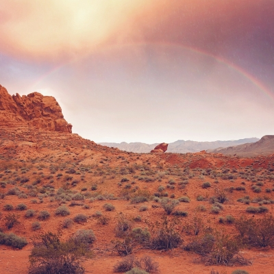 rainbow over mountain in desert