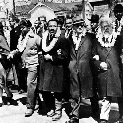 Heschel and King marching arm in arm at the march in Selma, 1965