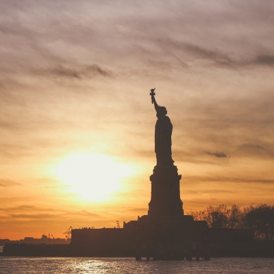 statue of liberty shown against sunset