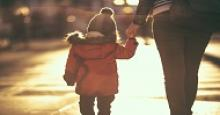 mother walking with young child holding hands