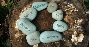 group of stones in a circle with words welcome hope love blessings pray