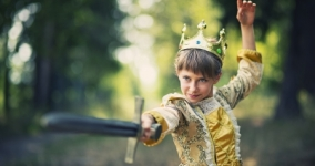 girl dressed as princess brandishing a sword