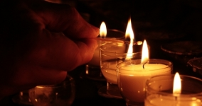 hand lighting candles