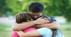 son hugging tightly sister and mother