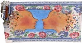 piece of art of two faces looking at one another with hair of hebrew letters