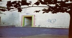 picture of CBST original entrance; a door with address over it and rainbow colors surrounding the door