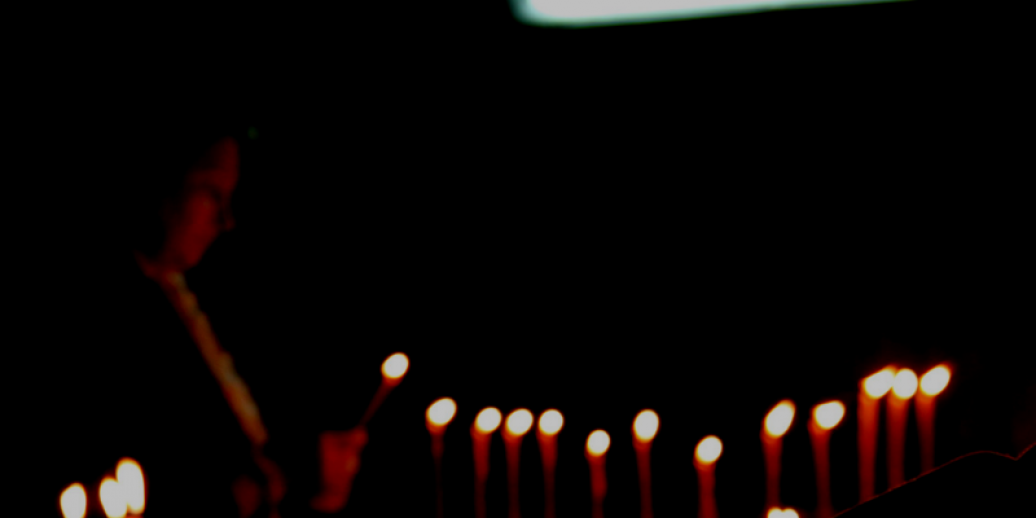 lighting candles in the dark