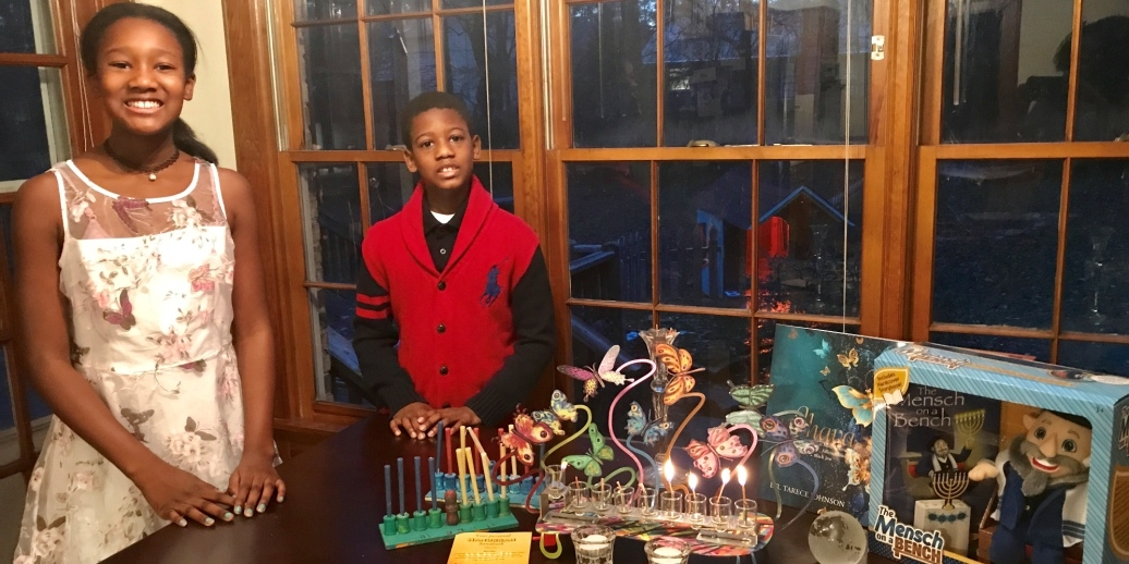 Tarece Johnson's children celebrating Hanukkah and Kwazaa with symbols from both cultures