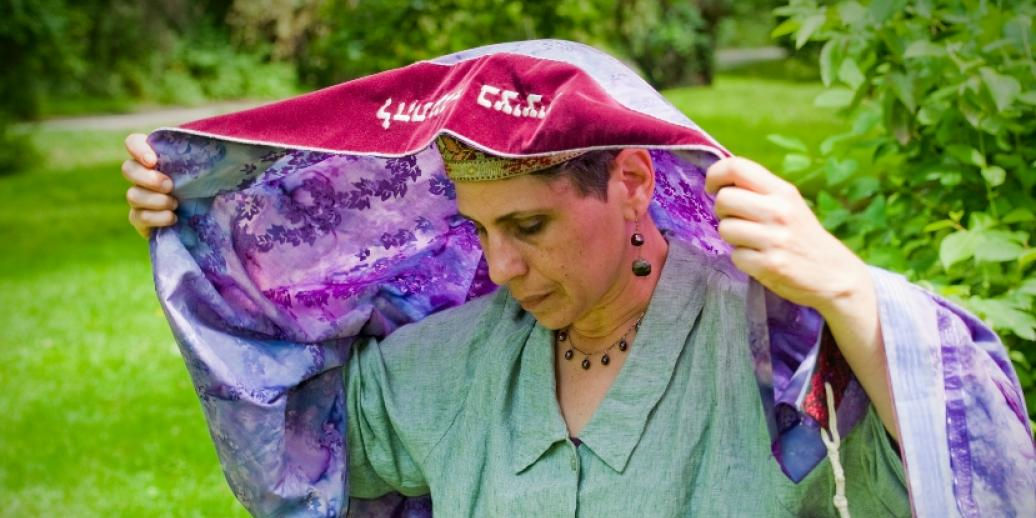 Woman with tallit over her head