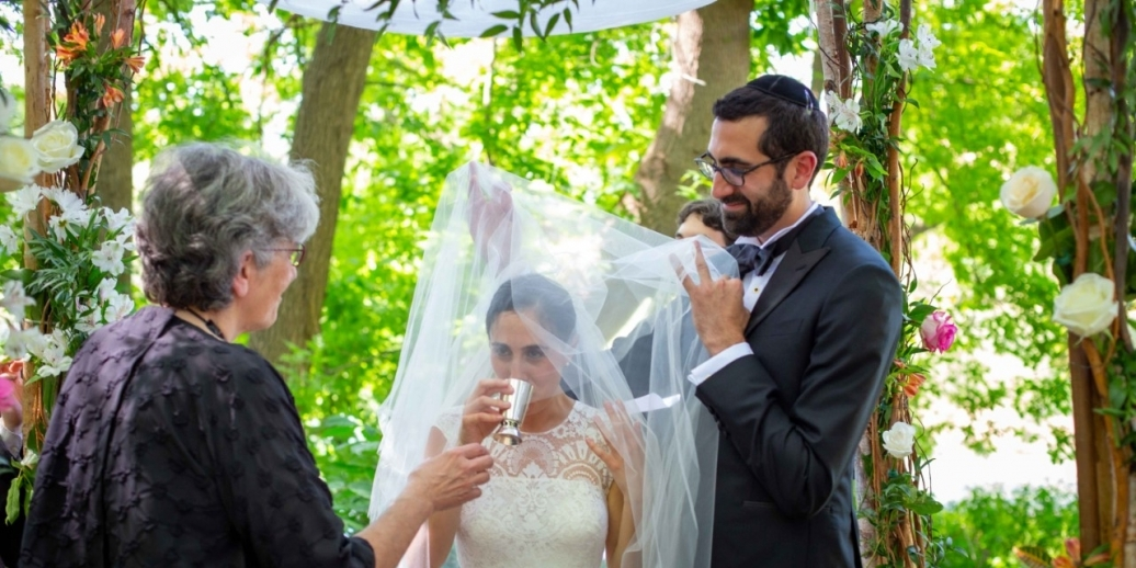 rabbi miriam liebman and groom under huppah getting married