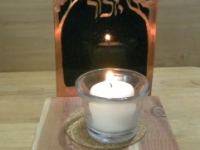 candle holder with trellis in the background and word yizkor