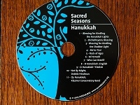 picture of sacred seasons cd, blue and black colors